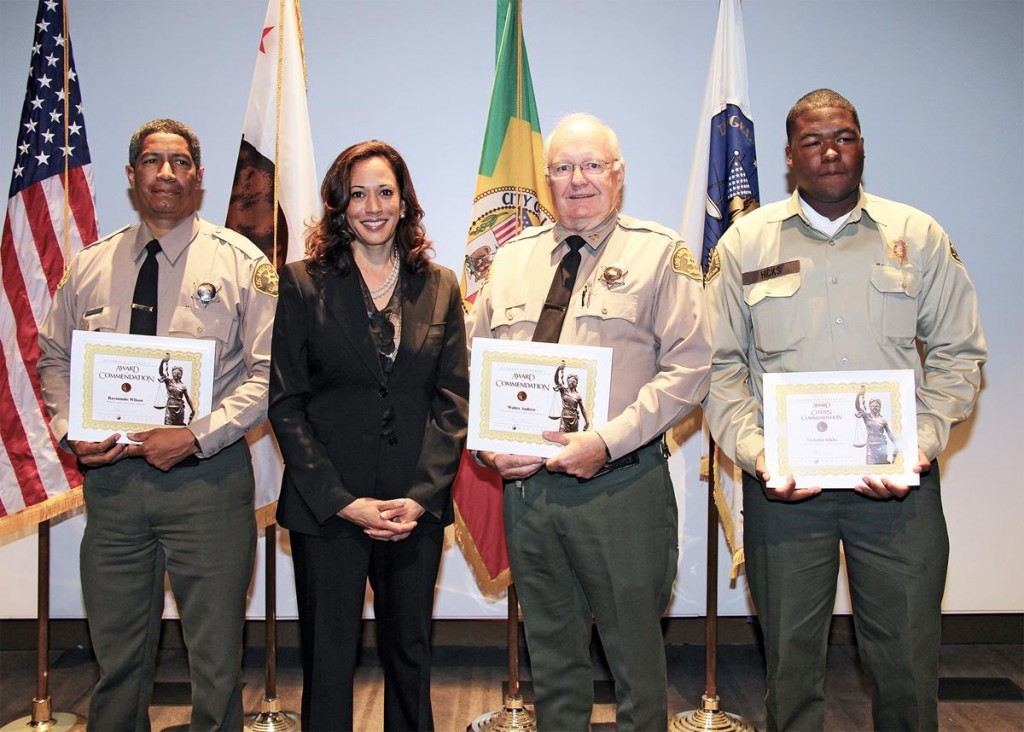 [L to R] Deputy Ray Wilson, Attorney General Kamala Harris, Reserve Captain Walt Andrew (retired CSO), Explorer Nicholas Hicks. The Palmdale trio received California Attorney General Commendation Awards on July 25. Attendees were Sheriff Lee Baca, LAPD Chief Charley Beck, other local law enforcement Captains. Other recipients from other local Los Angeles area Police Stations were also awarded.