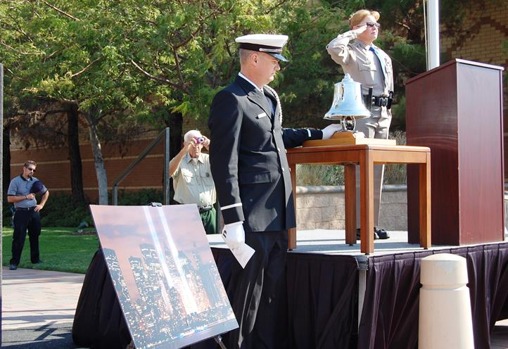 Firefighter Jeffrey Robson conducted the ringing of the bell, meant to remember and honor those who died on Sept. 11, 2001.