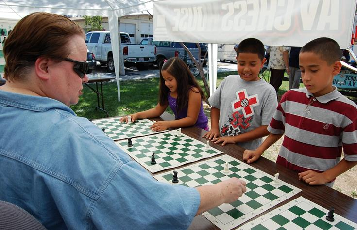 Local chess guru Daa Mahowald hosted an informational booth to teach eager youngsters the basics of the game.