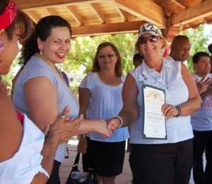 """Lancaster's Human Relations Tapestry Commissioner Sue Dell presented a certificate of recognition to the Festival Committee for """"promoting diversity and raising cultural awareness."""""""