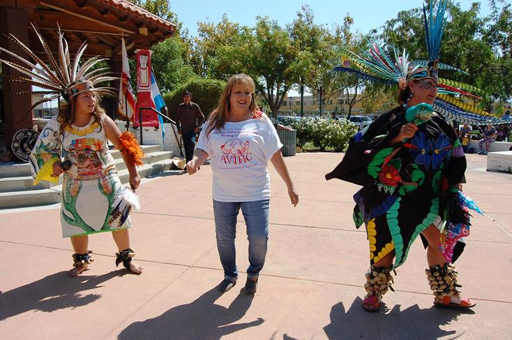 Festival organizer Elena Montgomery (center) joined dancers from Danza Azteca Mazatl for their performance finale.