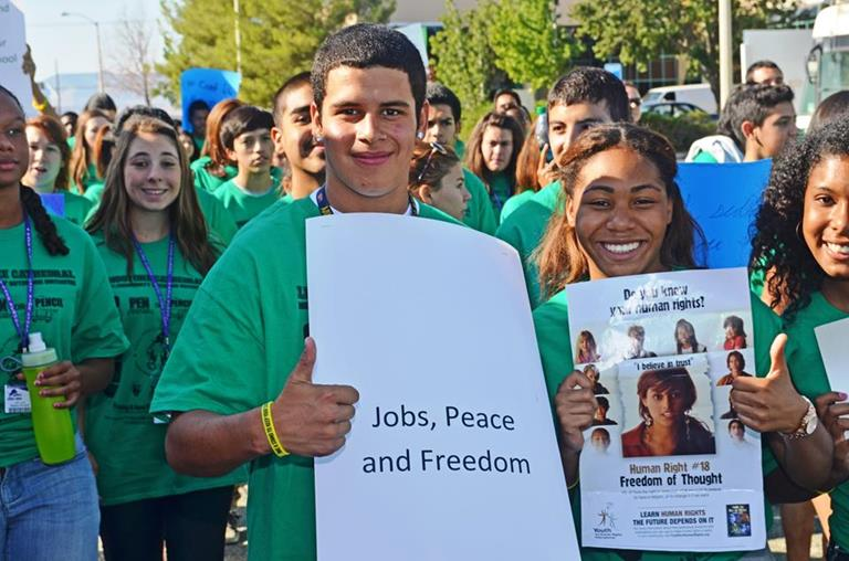 Students had signs proclaiming peace, jobs, freedom and human rights