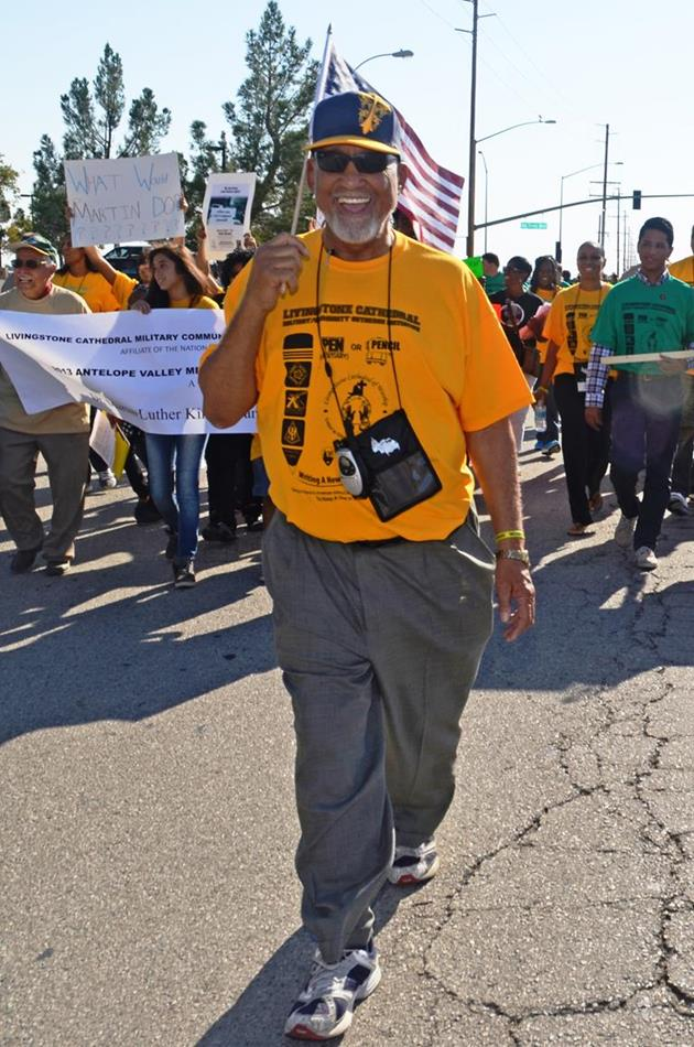 Lancaster Mayor Emeritus Bishop Henry Hearns led the AV Youth March holding an American flag. (Photo by TOM LLEWELLYN)
