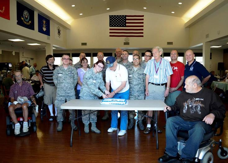"Veteran, Earl ""Andy"" Andrews, former Navy aviator, cuts the Air Force birthday cake surrounded by Air Force Sergeants Association volunteers and several other residents. AFSA served a barbeque lunch at the Lancaster Veterans Home recently in honor of the 66th Air Force birthday. ((U.S. Air Force photos by Rebecca Amber)"