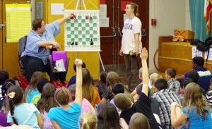 Daa and her daughter, Morgan, teach a Chess Mini-Game © to participants and community volunteers.
