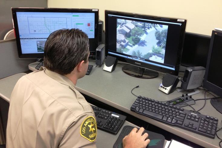 Deputy Jared Fletcher monitors recorded video of the incident using the Lancaster Station's Law Enforcement Aerial Platform System (LEAPS). (Photo courtesy LASD)