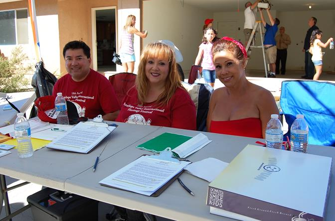 (L to R) Robert E. Alvarado, Elena Montgomery and Tina Alfaro and were on hand to help register the volunteers.
