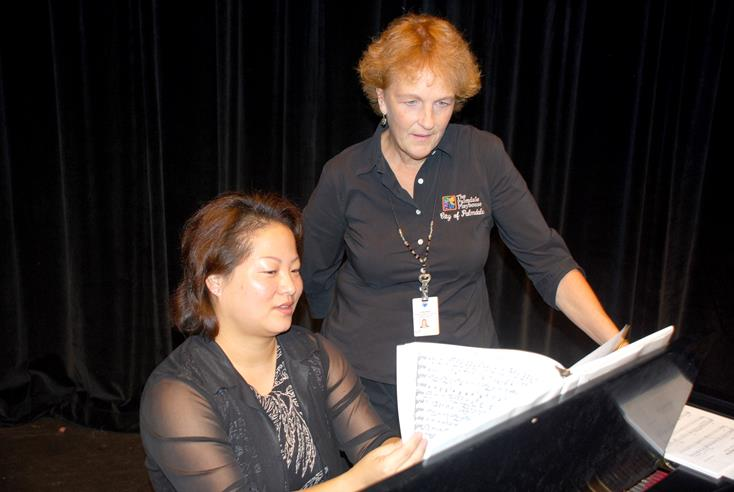 "Playhouse Theatre Operations Technician Linda Willis and Musical Director Jenny Chaney work through one of the pieces that will be performed at ""The 1940s Radio Show."" (Courtesy City of Palmdale.)"