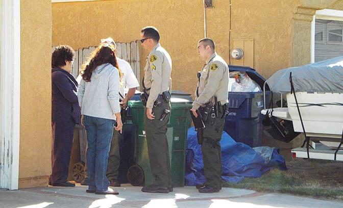 Deputies spoke to the missing teen's mother and grandmother outside the family's home Thursday afternoon, after the 15-year-old went outside to take out to trash and didn't come back. (Photo by LUIS MEZA)