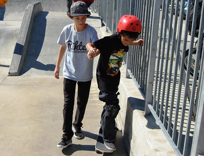 "At 13, Simi Valley resident Nick Livigni (left) is already a skilled skateboarder. ""One of my sponsors asked me to come here so I said why not? I really like helping other people and it makes me feel good,"" Livigni said, while giving lessons to 10-year-old Robert Rhoda."