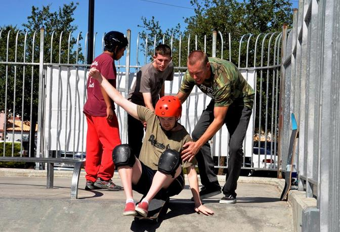 Joe Walker Middle School teacher and lifelong skateboarder Jeff Ryckebosh lends a hand to 24-year-old Torin Houle at last year's successful A.skate clinic at Marie Kerr Park.