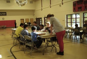 Morgan Mahowald provides a teachable moment during the October 26 Chess Spectacular.