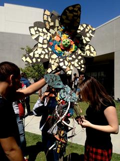 Flower sculptures were made entirely from trash collected at local illegal dump sites. (EDWIN VASQUEZ)