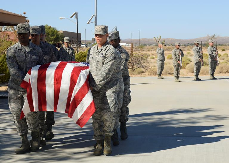 Seventeen Airmen performed a mock funeral during a graduation ceremony at the Airmen Leadership School where they became ceremonial guardsmen Oct. 16. (U.S. Air Force photo by Rebecca Amber).