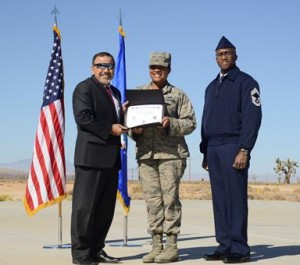 Alexander Kovras, 412th Force Support Squadron director (left) presented certificates to each of the graduates. (U.S. Air Force photo by Rebecca Amber).