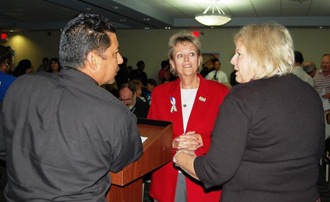 "(L to R) Union president Hugo Estrada, former superintendent Nancy Smith and Regina Riley chat before a forum Wednesday evening where Smith alleged budget mismanagement in Palmdale School District. District officials say Smith presented a ""narrow version of an analysis of the Palmdale School District budget"" with information taken out of context."