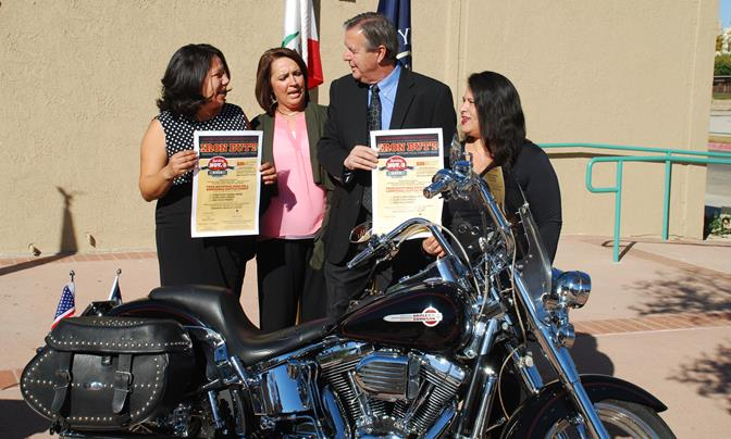 (L to R) Patricia Morales of SAVES, Terri-Lei Wheeler from the City of Palmdale, Palmdale Mayor Jim Ledford, and SAVES  staffer Haydee Johnson, discuss the 169 mile route of the Iron Butt Charity Ride, coming on Nov. 3.