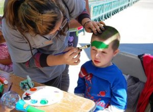 5-year-old Jaiden gets his face painted at the Laps4Literacy event.