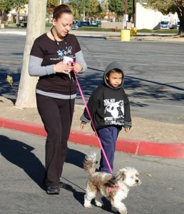 "Diana and her 4-year-old son Gabriel joined Coco for the 5K ""Run with Pets."""