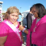 Support Waunette Cullors (right) pins 25-year breast cancer survivor Elena Vasquez.