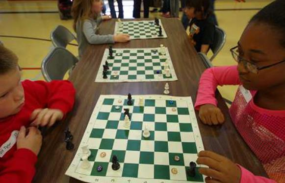 Several times during the event, at least 45 Chess Mini-Game©s were played simultaneously. (Photo by Matt Mahowald)