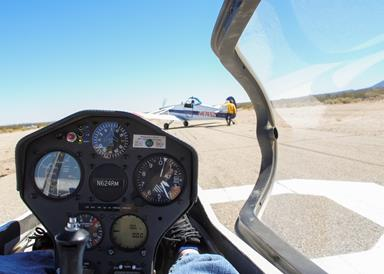Southern California Soaring Academy employees prepare for a customer flight by connecting the tow plane to the glider. (U.S. Air Force photo by Rebecca Amber)