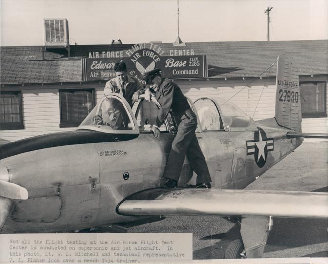 "An original photo of the production Beechcraft T-34 ""Mentor"" that hung in Club Muroc. The aircraft in the photo returned for a one-day visit 60 years after its service at Edwards AFB. The G-11 model was one of three T-34's that came to Edwards in October1953 for acceptance testing. (U.S. Air Force photo)"
