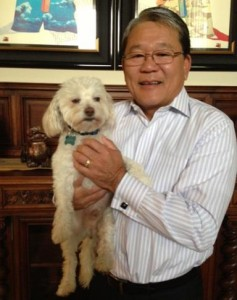 LA County CEO, William T. Fujioka, and his newest addition, Rudy, adopted from a county animal care center. (Contributed photo)