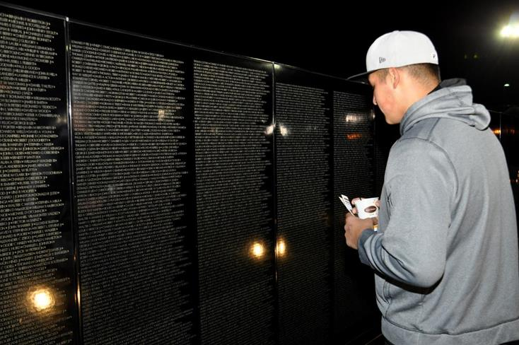 Many attendees paused to reflect at the AV Wall after the ceremony.