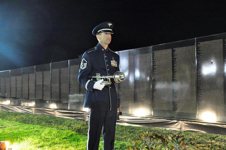 Master Sergeant Gerald Lockwood played Battle Hymn of the Republic on trumpet at the opening ceremony for the AV Wall last year.