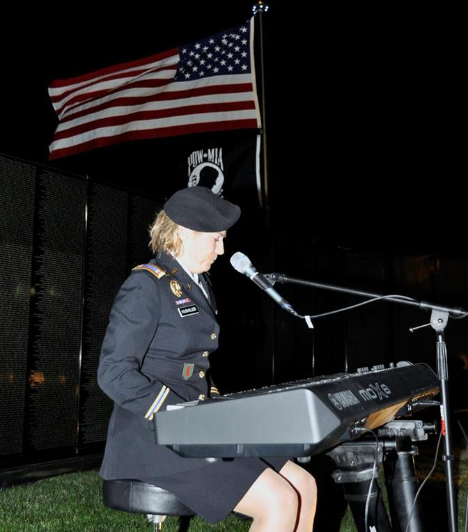 "Army Chief Warrant Officer 2 Jen Housholder sang a song she wrote  titled ""The Mission Continues."""