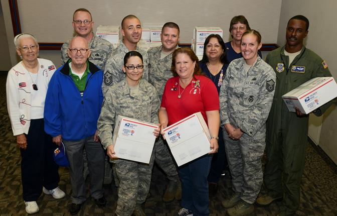 Members of the Antelope Valley Blue Star Mothers Chapter 14 partnered with the Edwards Airmen and Family Readiness Center to send care packages to deployed servicemembers for the holidays. (U.S. Air Force Photo by Rebecca Amber)