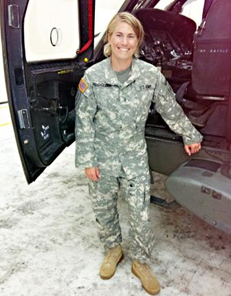 Army Chief Warrant Officer Two Jen Housholder stands in front of a UH-60 Blackhawk helicopter. Housholder works as an engineer in the 775th Test Squadron along with serving in the Army Reserve. (Courtesy photo)