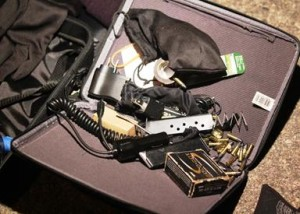 Deputies recovered ammunition, a gun magazine, shotgun shells, masks, gloves and other burglary tools from the vehicle.