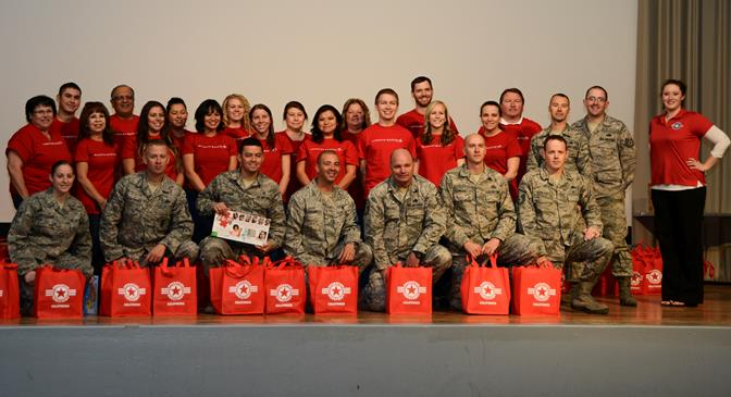 A group of Lockheed Martin employees and Edwards First Sergeants Council members partnered with Operation Homefront to bring Thanksgiving to Airmen in need Nov. 7 at the Base Theater. (U.S. Air Force photo by Rebecca Amber)
