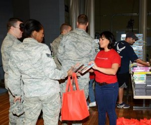 Victoria Van Conant, Lockheed Martin, showed Airmen their choices of DVDs for family entertainment. (Rebecca Amber)