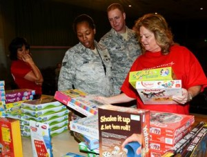 Suzie Vandever (right), Lockheed Martin, helped Airmen find a game to play following their Thanksgiving dinner this year. (Rebecca Amber)