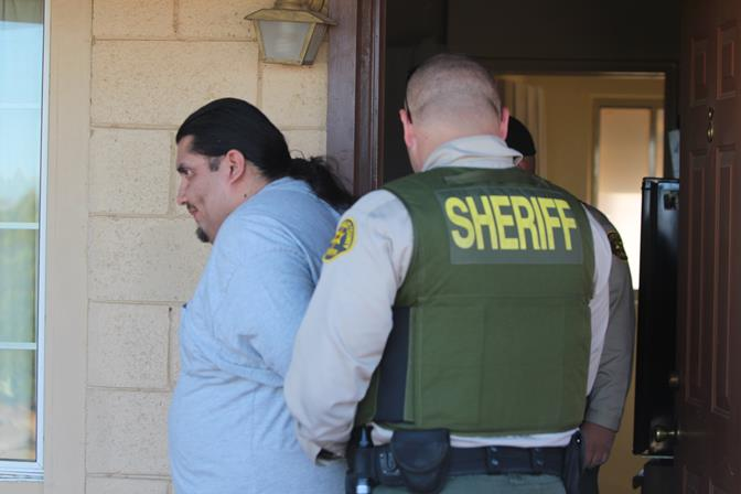 "Simon Soto, who is on parole for lewd or lascivious acts with a child under 14, was arrested at a Sierra Highway motel Friday morning in connection with ""Operation Boo."" (Photo by TONY CHEVAL)"