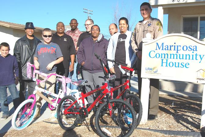 Parents and community volunteers met at the Mariposa Community House in Lancaster Saturday morning to assemble bicycles donated by the Antelope Valley Sheriff's Boosters Club with help from Walmart and Antelope Valley Harley Davidson.