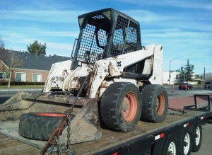 This Bobcat skid-steer loader was equipped with a LoJack, and deputies tracked to signal to Willis' Lancaster home.