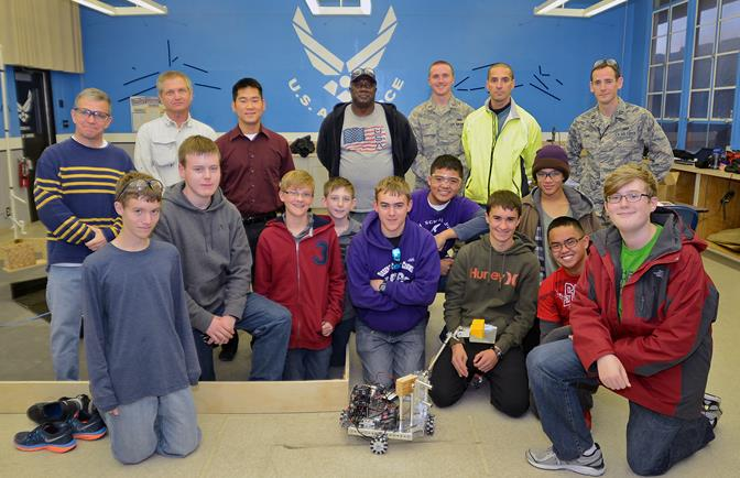 The newly-formed Desert Jr. and Sr. High School Scorpions Robotics Team pose for a team photo prior to preparing for their FIRST Tech Challenge robotics qualifying competition.  (U.S. Air Force photo by Jet Fabara)