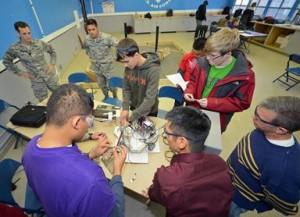 Desert Jr. and Sr. High School students from the DHS Scorpions Robotics Team work on their autonomous robot. (Jet Fabara)