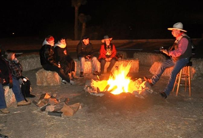 Cowboy singer Michael Tcherkassky performs a bonfire at the 2011 event. (Contributed photo by John Martin)