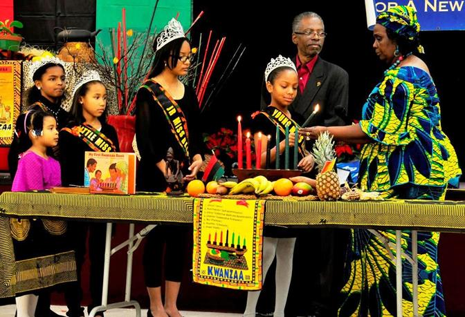 The Black Antelope Valley community queens took part in the ceremonial lighting of the seven candles, representing the principles of Kwanzaa.