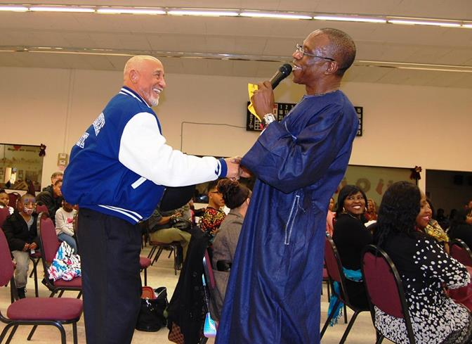 Tunde Obazee (right) inspired the 200-plus crowd through song and spoken word. He even got Lancaster Mayor Emeritus Henry Hearns (left) on his feet.