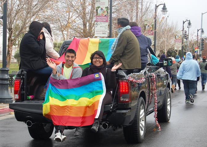 A rainbow colored flag kept members of the OUTreach Center warm.