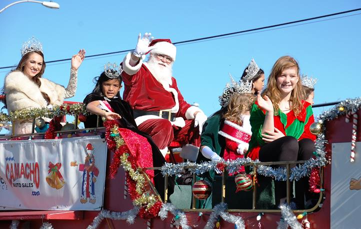 The two-hour parade wrapped with a special appearance by Santa Claus, surrounding by community queens.