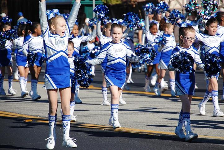 The girls from Dazzler Cheer remained enthusiastic even towards the end of the one-mile parade route.