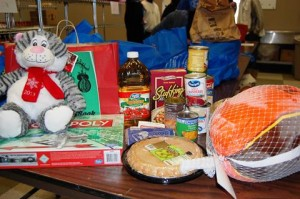 Each family received a frozen turkey and all the items needed for a holiday dinner.