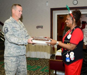 Linda Crump (right), receives a cookie donation from Master Sgt. James Pilkenton. (U.S. Air Force photo by Rebecca Amber)
